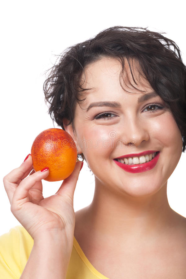 Download Woman with red orange stock photo. Image of citrus, caucasian - 67008666