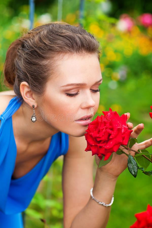 Woman with red rose royalty free stock photography