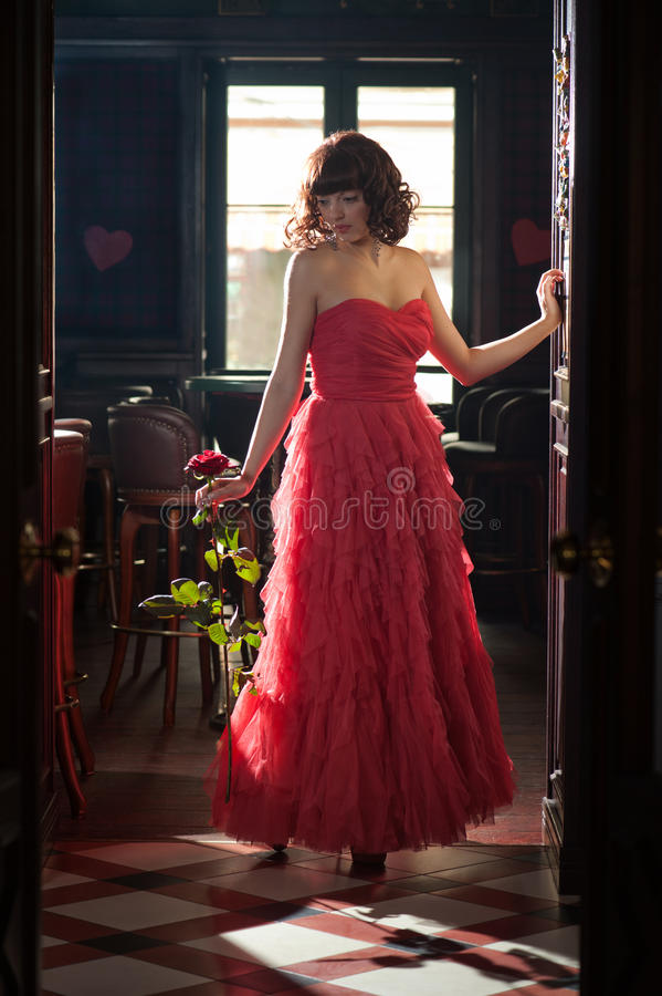 Download Woman in red with the rose stock image. Image of cute - 24412435