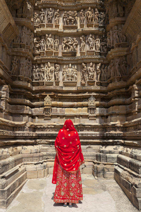 Woman in red sari, Khajuraho. stock images