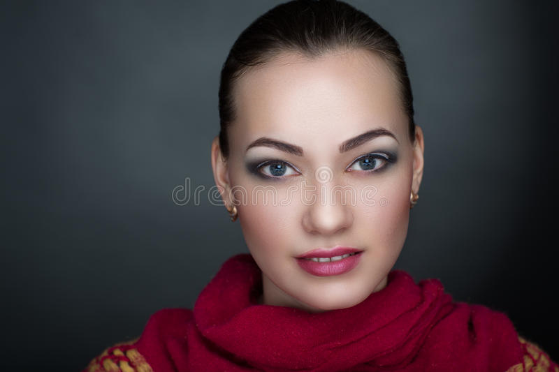 Woman with red scarf. Opened eyes pretty woman Young beautiful brunette lady model princess actress bright stylish look. Chic impressive appearance. Perfect face stock photography