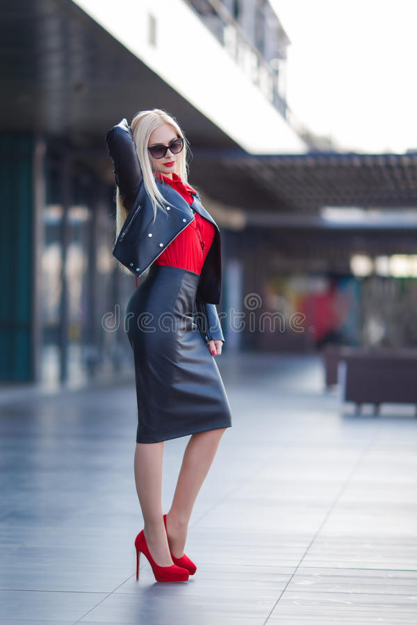 Woman in the red shirt posing at the street stock photos
