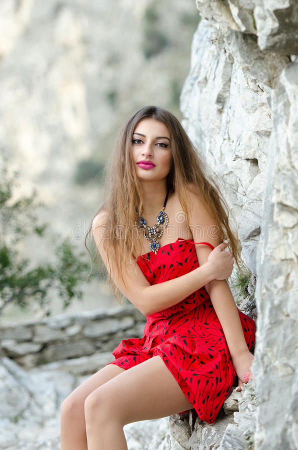 Woman In Red Short Dress And Big Necklace Stock Photo -6004