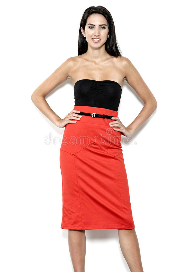 Woman in red skirt. Beautiful young woman in red pencil skirt royalty free stock photography