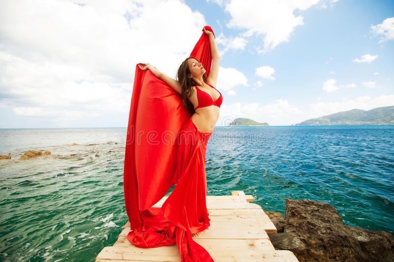 woman with red skirt and fabric royalty free stock photos