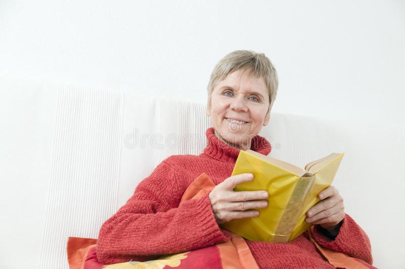 Download Woman in red smiling stock photo. Image of home, care - 33534916