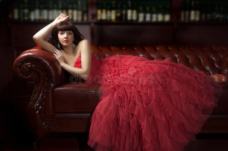 Woman in red on the sofa