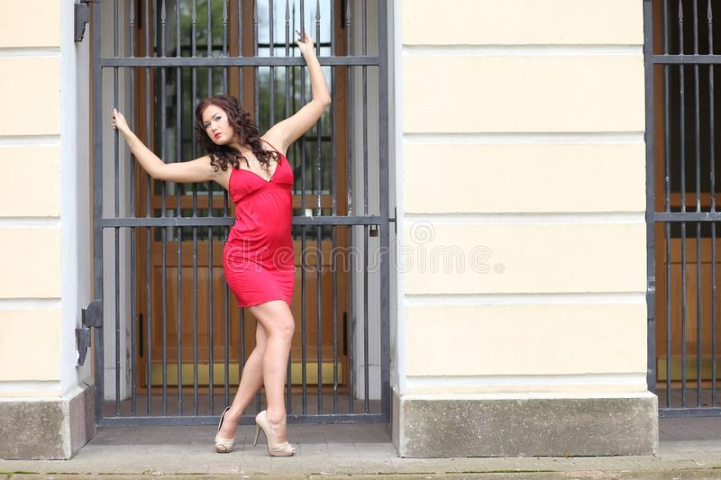 Woman in red summer dress royalty free stock photography