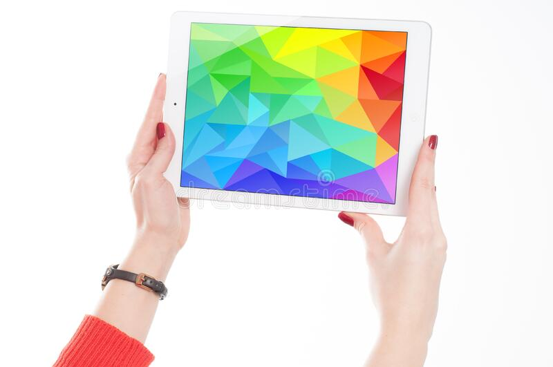 Woman in Red Sweater Holding White Ipad stock image