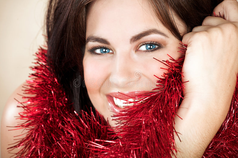 Woman with red tinsel stock images