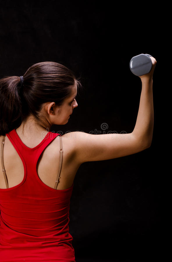 Woman in red top working out royalty free stock photo