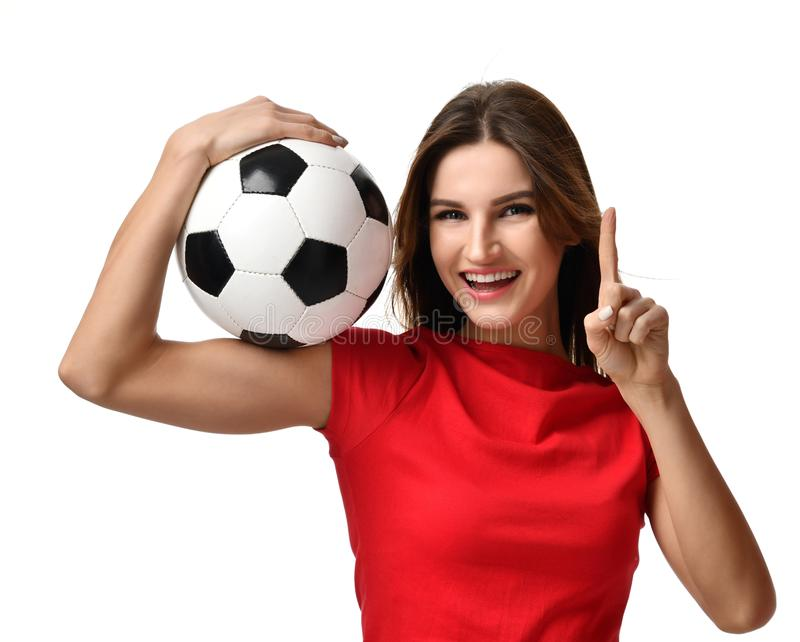 Woman in red tshirt hold soccer ball celebrating point one finger up winner sign free text copy space. Fan sport woman in red tshirt hold soccer ball celebrating stock photography