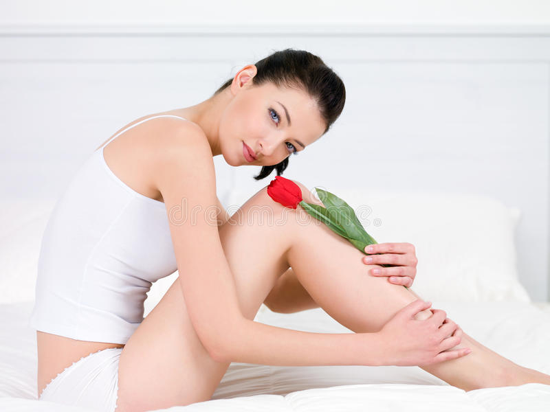 Download Woman With Red Tulip On Legs Stock Photo - Image: 15090036
