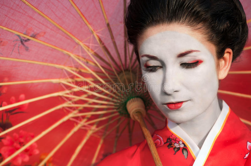 Woman with red umbrella stock image