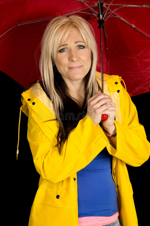 Woman red umbrella and yellow jacket funny expression stock photography