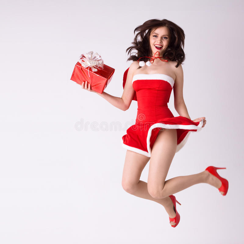 Woman In Red Xmas Costume Fly With Gift Royalty Free Stock Photos