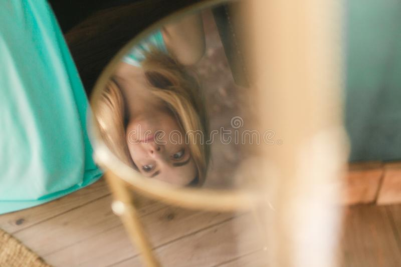Woman reflection in glass table at home.  stock images