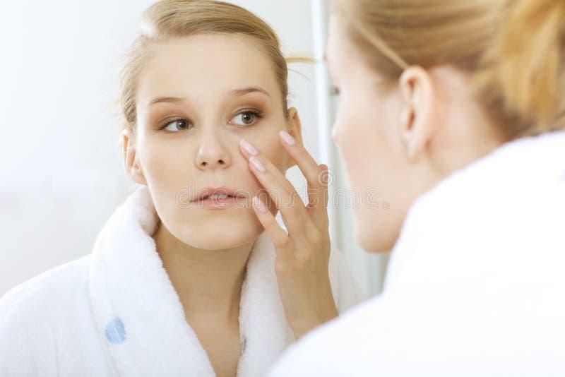 woman reflexion in mirror stock photo