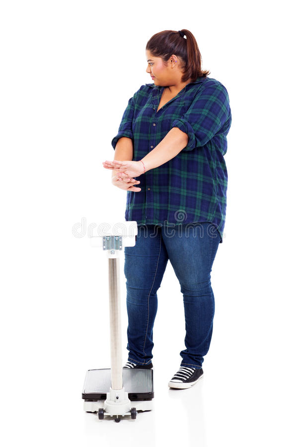 Woman refuse scale. Overweight woman refuse to go on scale for weighting stock image