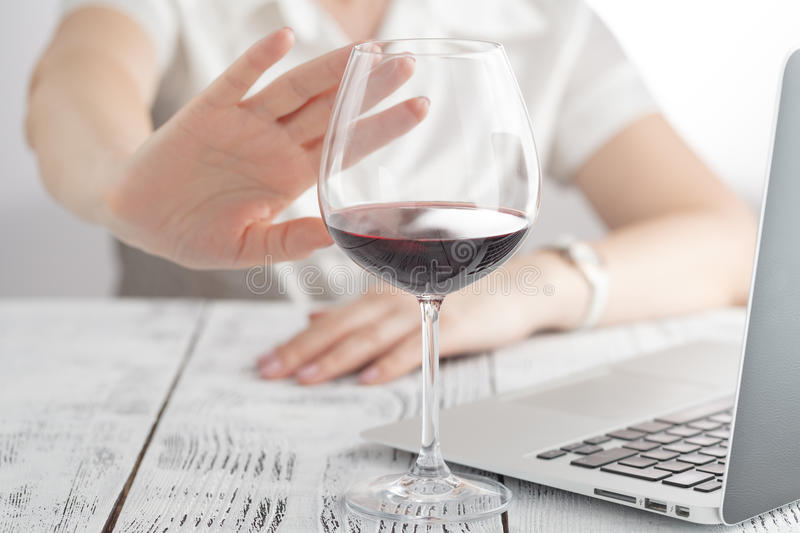 Woman refuses to drink a wine royalty free stock image