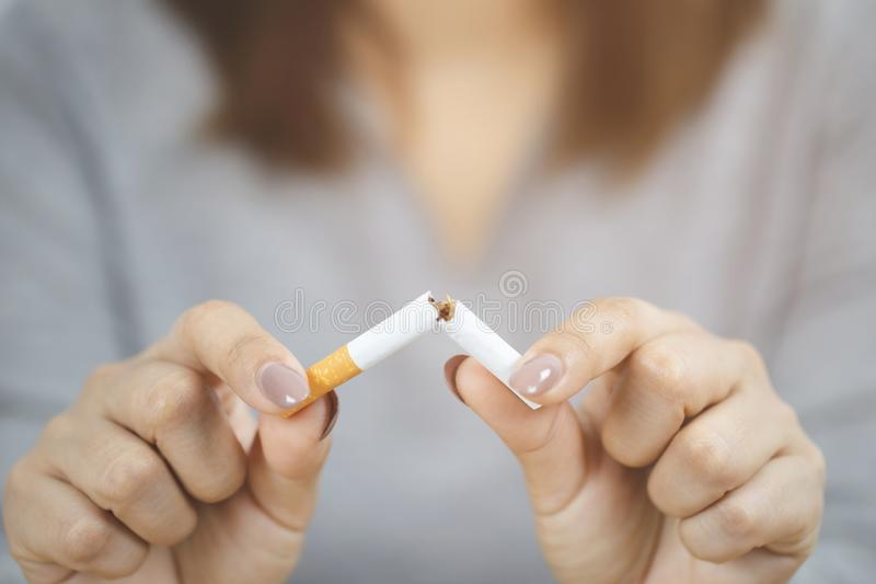 Woman refusing cigarettes concept for quitting smoking and healthy lifestyle. Or No smoking campaign Concept royalty free stock photos