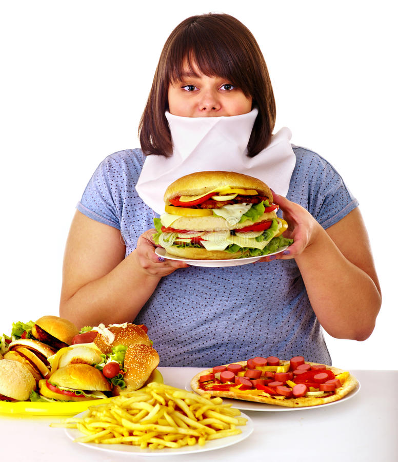 Woman refusing fast food. Overweight woman refusing fast food royalty free stock photos