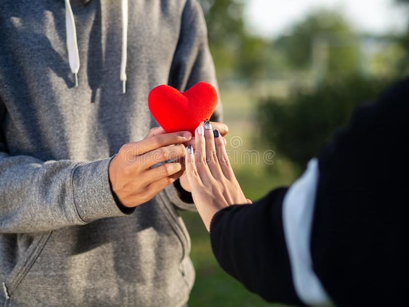 Woman refusing red heart form the man. Broken heart, Love, Valentine`sDay Concept royalty free stock photography