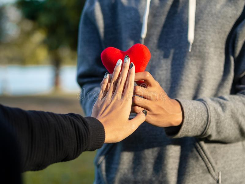 Woman refusing red heart form the man. Broken heart, Love, Valentine`sDay Concept royalty free stock photo