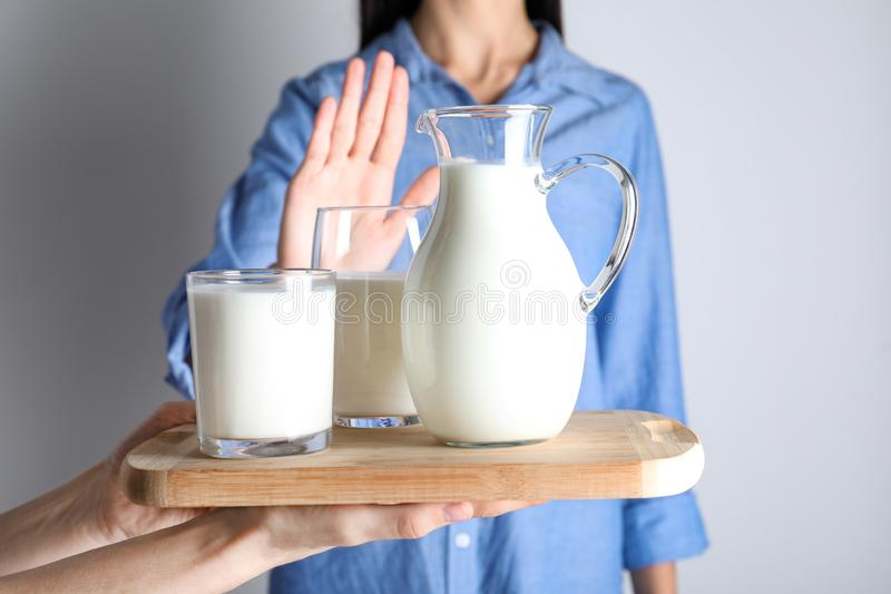 Woman refusing to drink milk. Food allergy concept. Woman refusing to drink milk, closeup. Food allergy concept royalty free stock photography