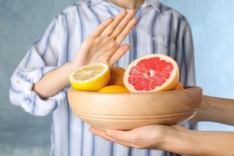Woman refusing to eat citrus fruits. Food allergy concept. Woman refusing to eat citrus fruits, closeup. Food allergy concept stock photos