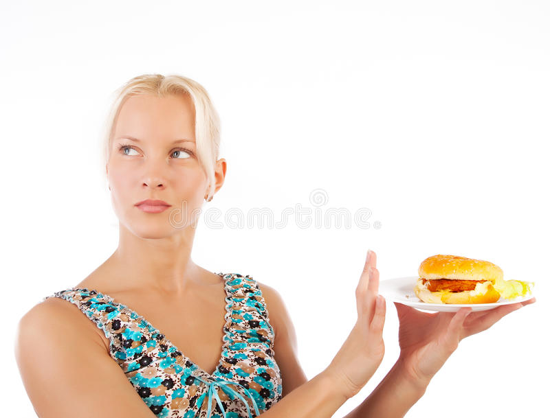 Woman refusing to eat unhealthy food. Portrait of woman refusing to eat unhealthy fast food royalty free stock photo