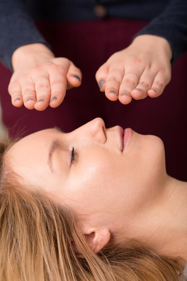 Woman in reiki healing session royalty free stock images