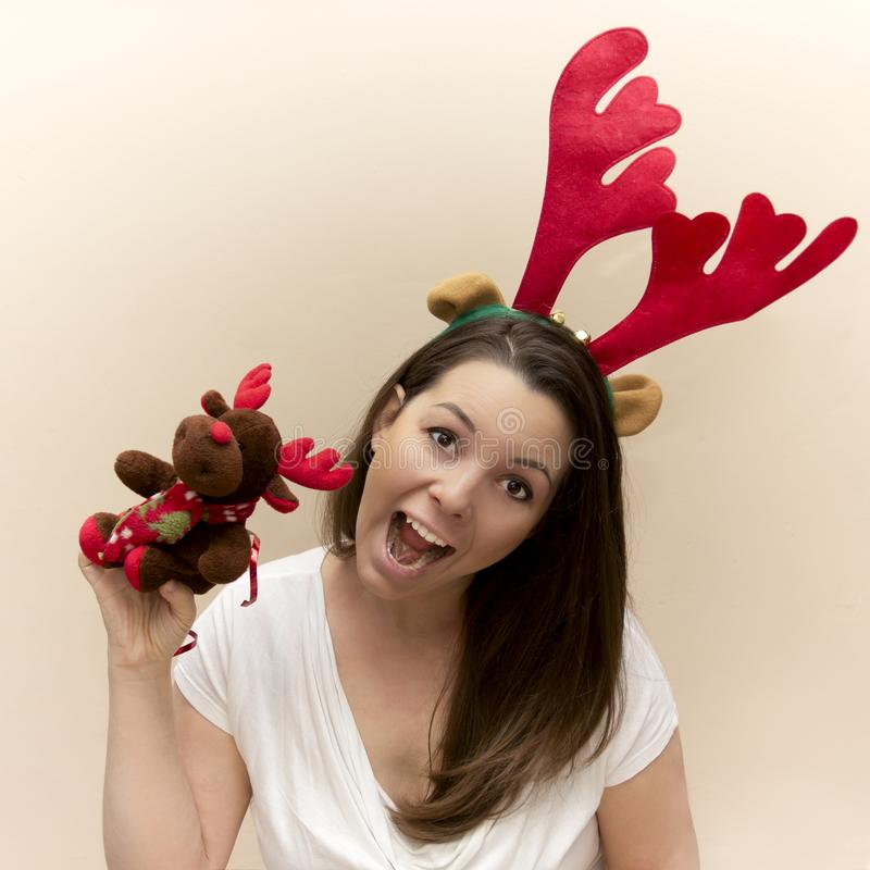 Woman in a reindeer costume stock photo