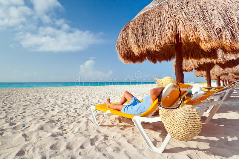 Woman At Relaxation Under Parasol Stock Photos