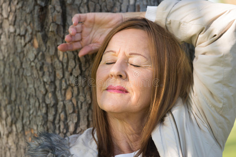 Woman relaxed closed eyes outdoors stock images