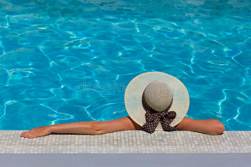 Woman relaxed at the pool stock image