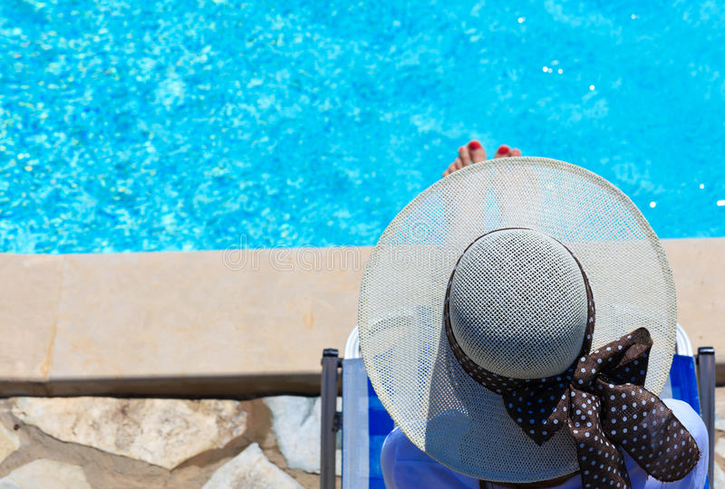 Woman relaxed at the pool royalty free stock image