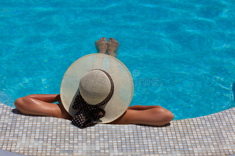 Woman relaxed at the pool royalty free stock photo