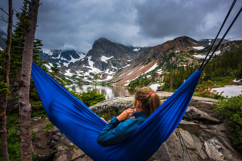 Woman relaxes on a hammock lake Isabelle Colorado. Woman relaxes on a hammock lake isabelle indian peaks wilderness Colorado Tourism royalty free stock photography