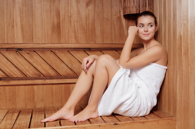 Woman relaxes in sauna royalty free stock photos