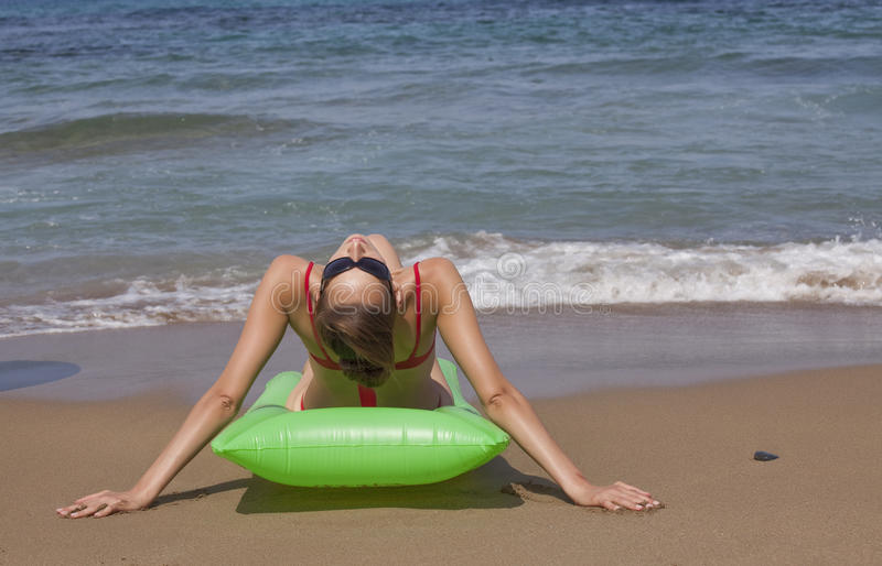 Download Woman Relaxing On An Air Mattress Stock Photos - Image: 11242683
