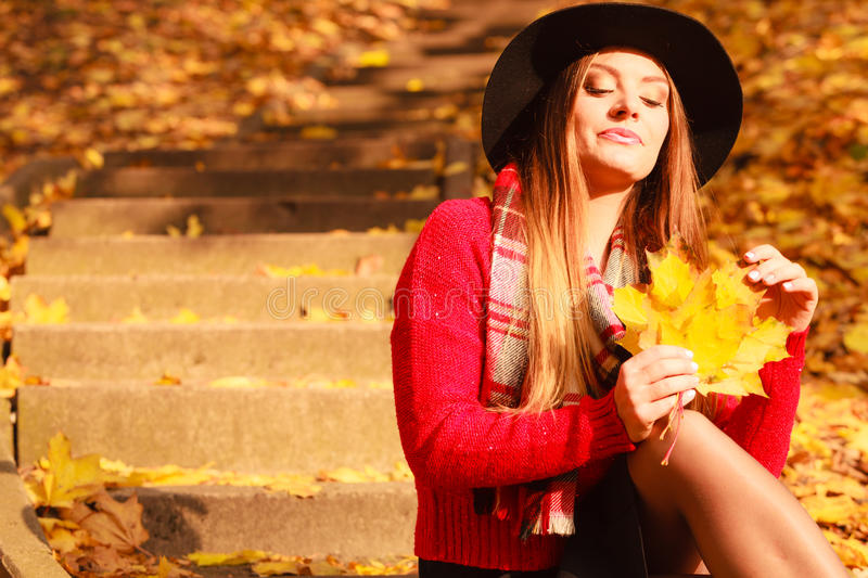 Woman relaxing in autumn fall park royalty free stock images