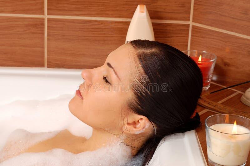 Woman relaxing in bath stock photos
