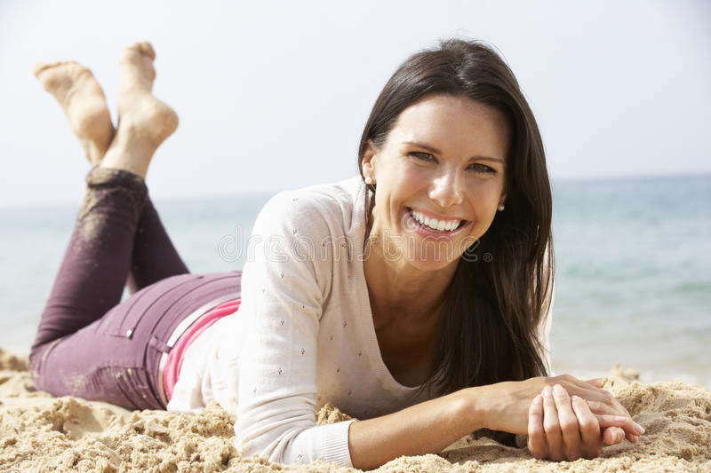 Woman Relaxing On Beach stock image