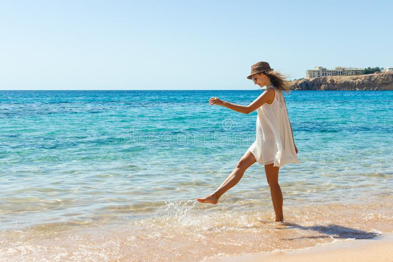Woman relaxing at beach enjoying summer freedom. Happ girl at the beach stock photo