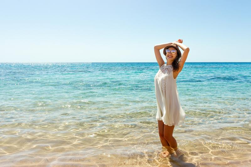 Woman relaxing at beach enjoying summer freedom. Happ girl at the beach royalty free stock photography