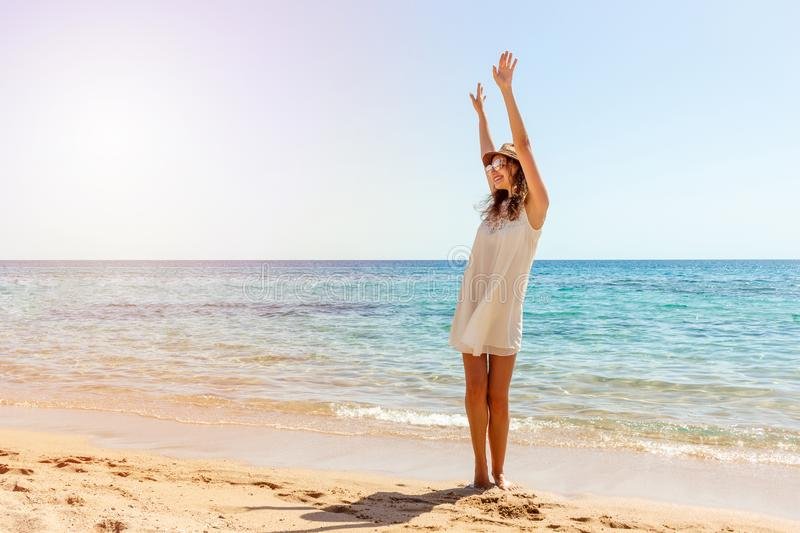 Woman relaxing at beach enjoying summer freedom. Happ girl at the beach stock photography