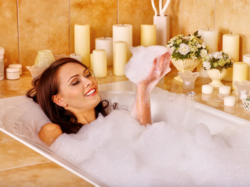 Woman relaxing at bubble bath. Woman relaxing at water in bubble bath stock photography