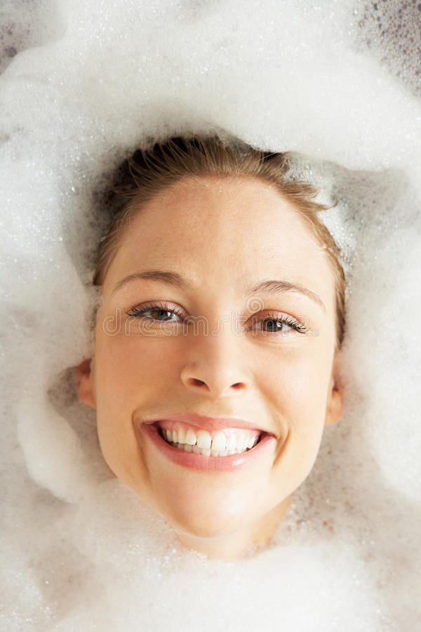 Download Woman Relaxing In Bubble Filled Bath Stock Image - Image: 27271377