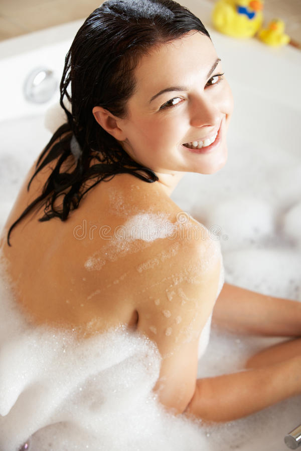 Download Woman Relaxing In Bubble Filled Bath Stock Image - Image: 27272119
